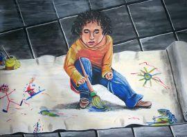 Junge mit Pinsel und Farbe